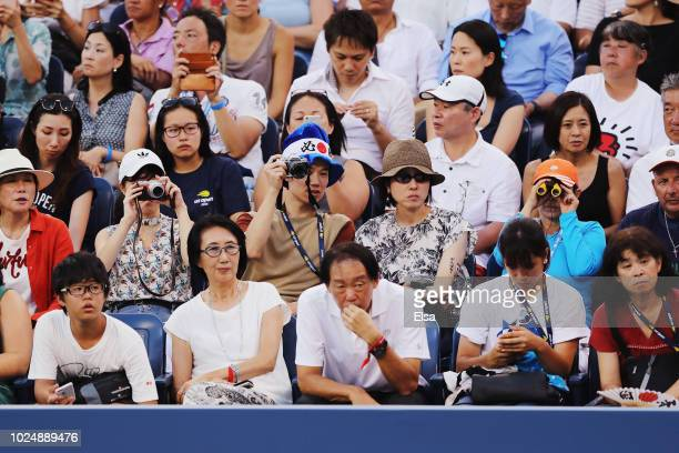 Fans watch the men's singles first round match between Maximilian Marterer of Germany and Kei Nishikori of Japan on Day Two of the 2018 US Open at...