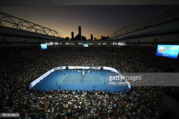TOPSHOT Fans watch the men's singles semifinal match between Spain's Rafael Nadal and Bulgaria's Grigor Dimitrov on day 12 of the Australian Open...