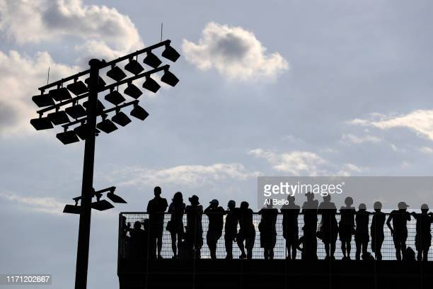 Fans watch the Men's Singles third round match between David Goffin of Belgium and Pablo Cuevas of Uruguay on day five of the 2019 US Open at the...