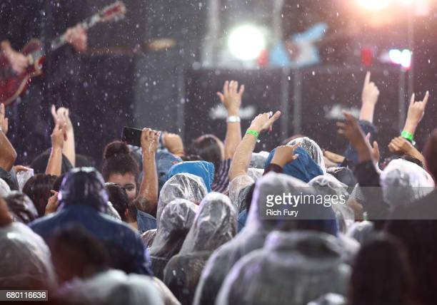 Fans watch the musical band All Time Low perform as rain falls during the concert at the 2017 MTV Movie And TV Awards Festival at The Shrine...