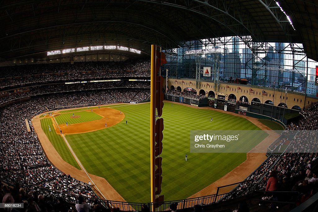 Fans watch the Opening Day game against the Chicago Cubs and the Houston Astros on April 6, 2009 at Minute Maid Park in Houston, Texas.