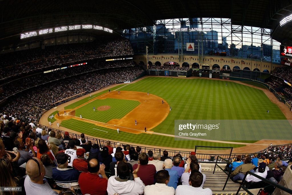 Fans watch the Opening Day game between the Chicago Cubs and the Houston Astros on April 6, 2009 at Minute Maid Park in Houston, Texas.