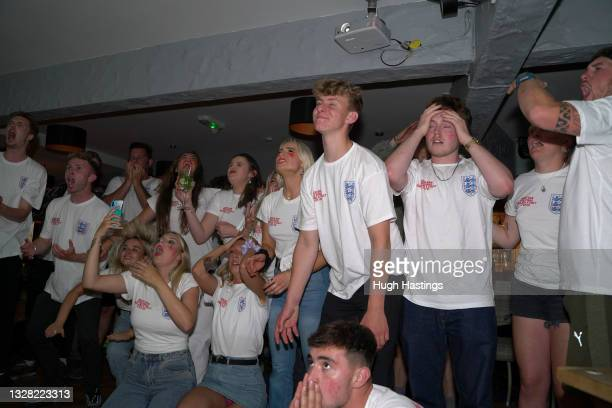 Fans watch the penalty shoot-out during the UEFA Euro 2020 Championship Final between Italy and England at Fistral Beach Bar on July 11, 2021 in...