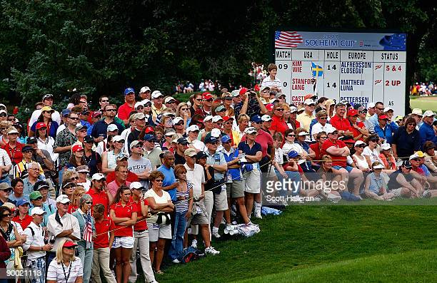Fans watch the play on the 14th hole during the saturday morning fourball matches at the 2009 Solheim Cup at Rich Harvest Farms on August 22 2009 in...