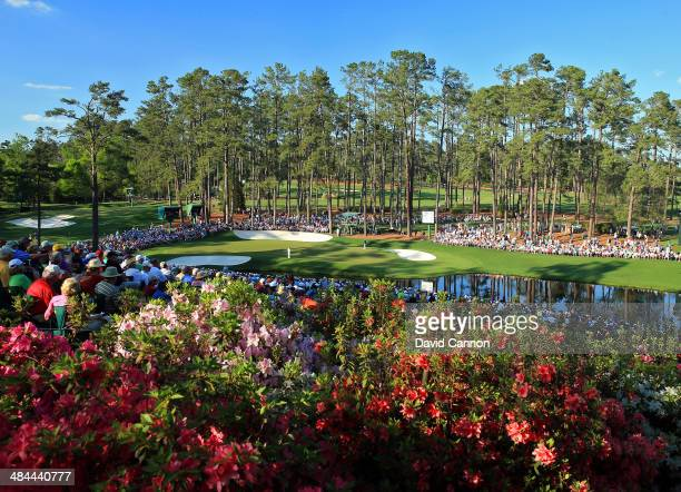Fans watch the play on the 16th hole during the third round of the 2014 Masters Tournament at Augusta National Golf Club on April 12 2014 in Augusta...