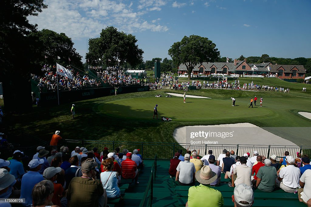 Fans watch the play on the 18th green during the first round of the 2013 U.S. Senior Open Championship at Omaha Coutry Club on July 11, 2013 in Omaha, Nebraska.