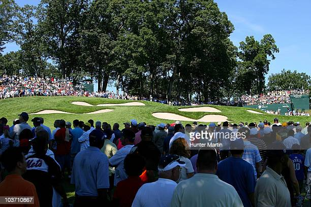 Fans watch the play on the fifth hole during the final round of The Barclays at the Ridgewood Country Club on August 29 2010 in Paramus New Jersey