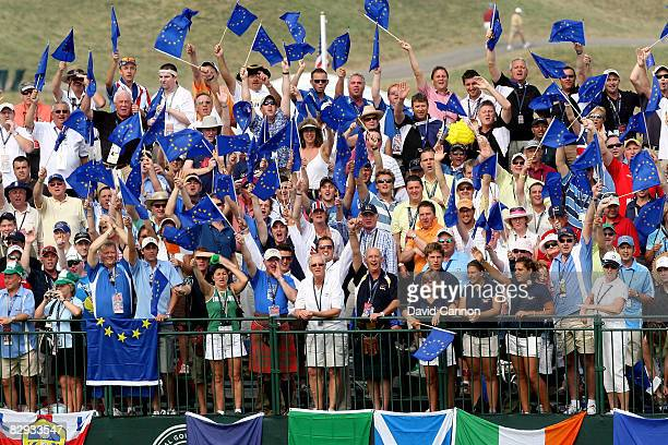 Fans watch the play on the first tee during the singles matches on the final day of the 2008 Ryder Cup at Valhalla Golf Club on September 21 2008 in...