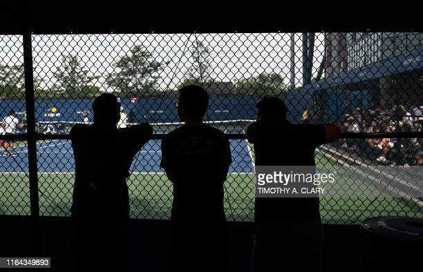 Fans watch the practice court at the 2019 US Open at the USTA Billie Jean King National Tennis Center in New York on August 27 2019