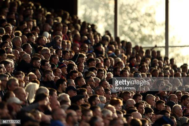 Fans watch the Premier League match between Crystal Palace and West Ham United at Selhurst Park on October 28 2017 in London England
