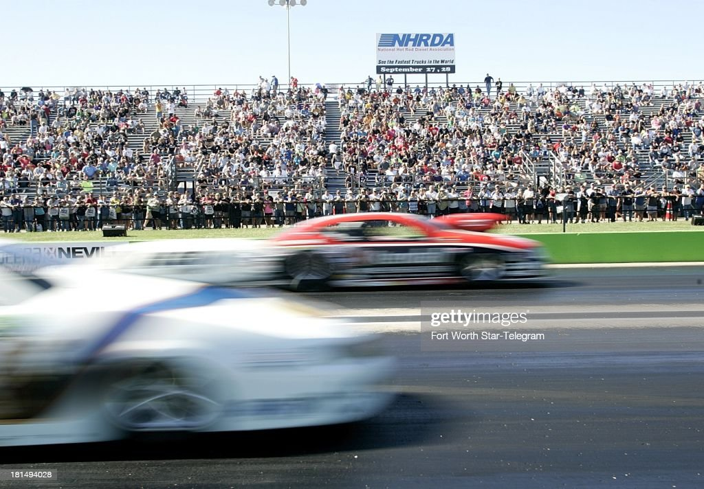 Fans watch the Pro Stock races during the Texas Fall Nationals at Texas Motorplex in Ennis, Texas, on Saturday, September 21, 2013.