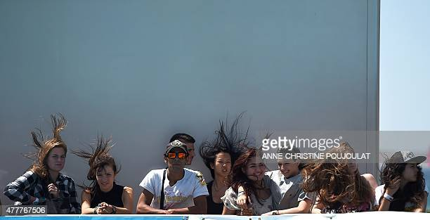 Fans watch the qualifying rounds of the French stage of the World Cup Skateboarding ISU during the Sosh Freestyle Cup June 19 2015 on the Prado...