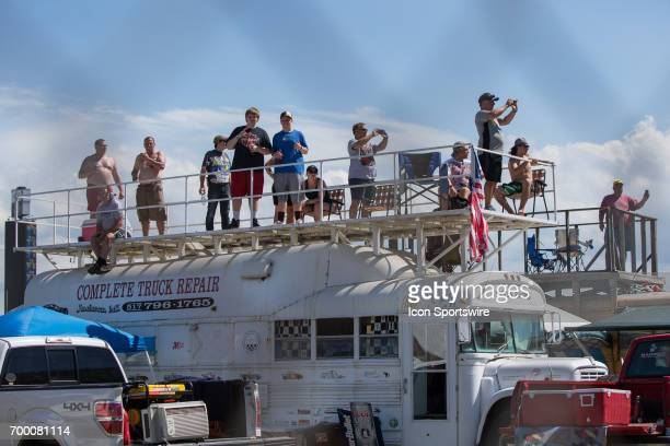 Fans watch the race from a converted school bus during the Monster Energy Cup Series Firekeepers Casino 400 race on June 18 2017 at Michigan...