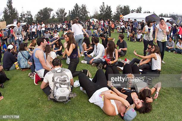Fans watch the shows during the Corona Capital Festival day 1 at Hermanos Rodriguez Racetrack on October 11 2014 in Mexico City Mexico