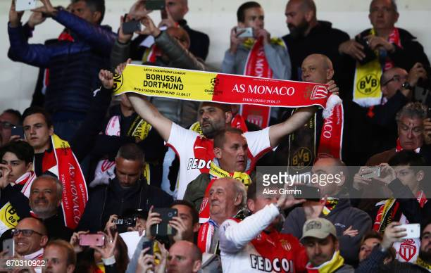 Fans watch the UEFA Champions League Quarter Final second leg match between AS Monaco and Borussia Dortmund at Stade Louis II on April 19 2017 in...