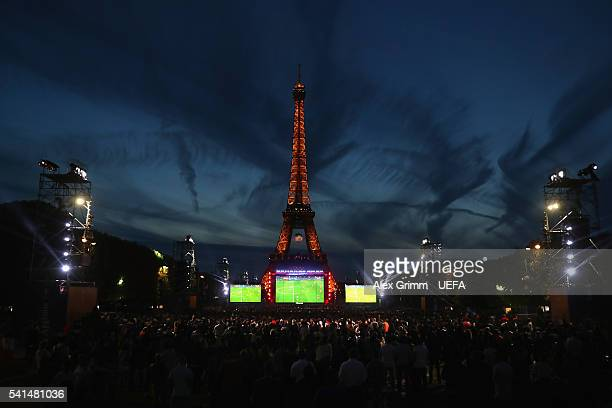 Fans watch the UEFA EURO 2016 Group A match between Switzerland and France on a giant screen at the Eiffel Tower fan zone on June 19 2016 in Paris...