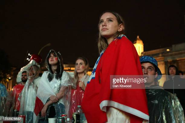 Fans watch the UEFA Euro 2020 Championship Final between Italy and England, at the UEFA 2020 Fan Zone in Trafalgar Square on July 11, 2021 in London,...