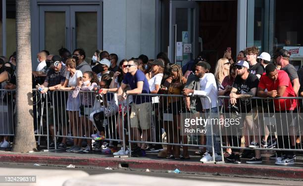 """Fans watch the Universal Pictures """"F9"""" World Premiere at TCL Chinese Theatre on June 18, 2021 in Hollywood, California."""
