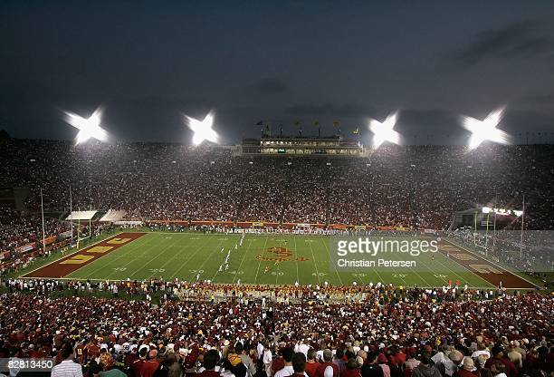 Fans watch the USC Trojans and the Ohio State Buckeyes compete at Los Angeles Memorial Coliseum on September 13 2008 in Los Angeles California The...