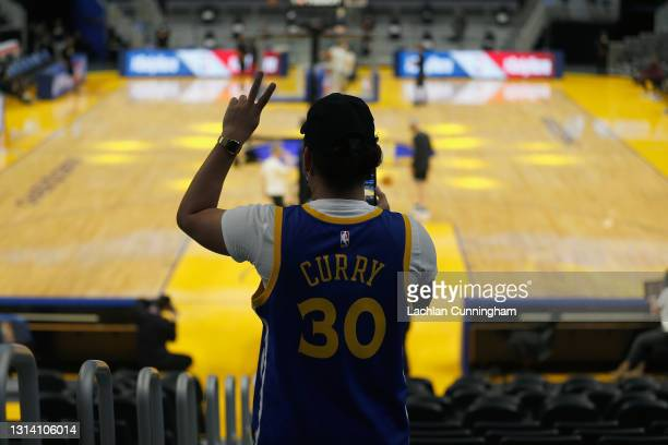Fans watch the warm up before the game between the Golden State Warriors and the Denver Nuggets at Chase Center on April 23, 2021 in San Francisco,...