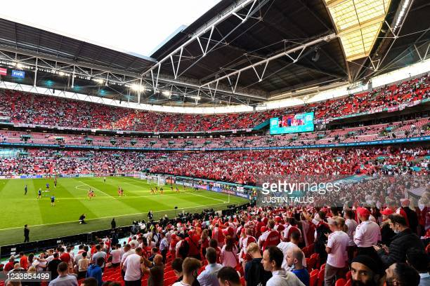 Fans watch the warm ups ahead of the UEFA EURO 2020 semi-final football match between England and Denmark at Wembley Stadium in London on July 7,...