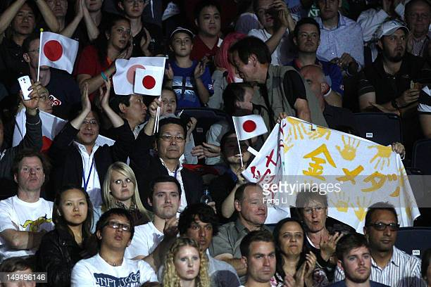 Fans watch the Women's Singles Table Tennis third round match between Ai Fukuhara of Japan and Anna Tikhomirova of Russia on Day 2 of the London 2012...