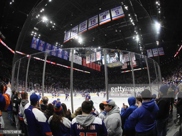 Fans watch warm-ups prior to the game between the New York Islanders and the Columbus Blue Jackets at the Nassau Veterans Memorial Coliseum on...