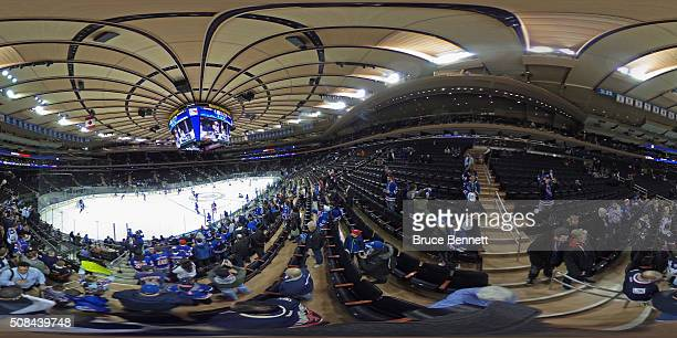 Fans watch warmups prior to the game between the New York Rangers and the Minnesota Wild at Madison Square Garden on February 4 2016 in New York City