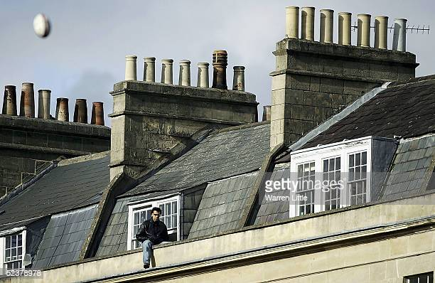 A fans watches a converted kick from his apartment during the Zurich Premiership match between Bath Rugby and Worcester Warriors at The Recreation...