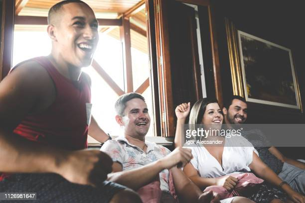 fans watching a game at home - sports event stock photos and pictures
