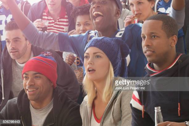 Fans watching American football game