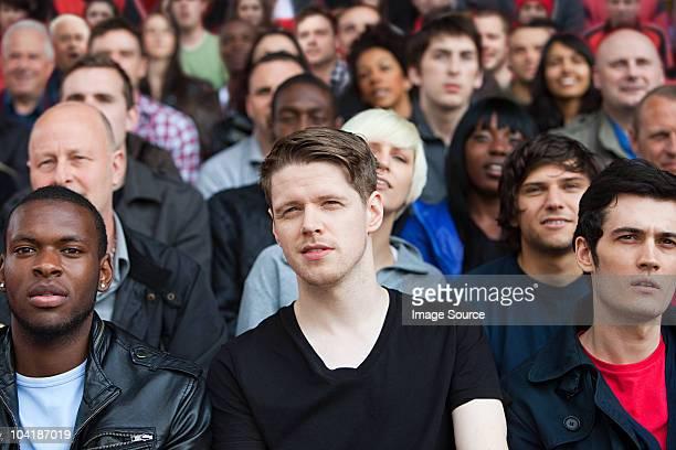 fans watching football match - menigte stockfoto's en -beelden
