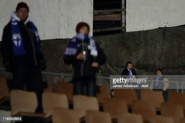 Fans watching from a cliff ledge outside the Telia 5G -areena home of HJK and HIFK in Helsinki, Finland during the UEFA Euro 2020 Qualifier between...