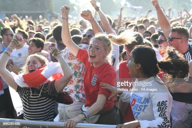 Fans watching in Hyde Park London celebrate England's goal from Keiran Trippier in the FIFA World Cup semi final match between Croatia and England