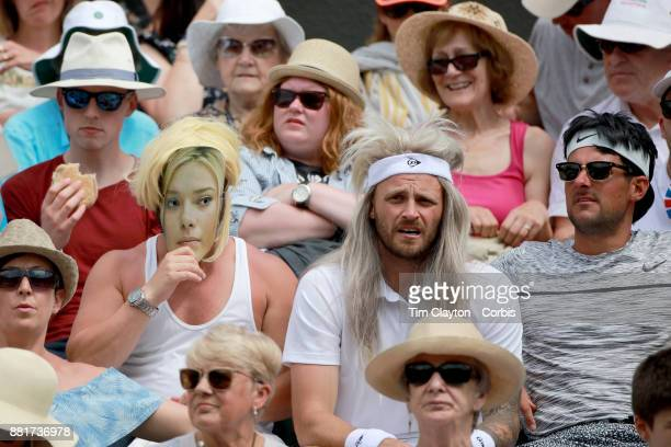 Fans watching Johanna Konta of Great Britain in action against Caroline Garcia of France in the Ladies' Singles round of 16 on NO1 Court during the...