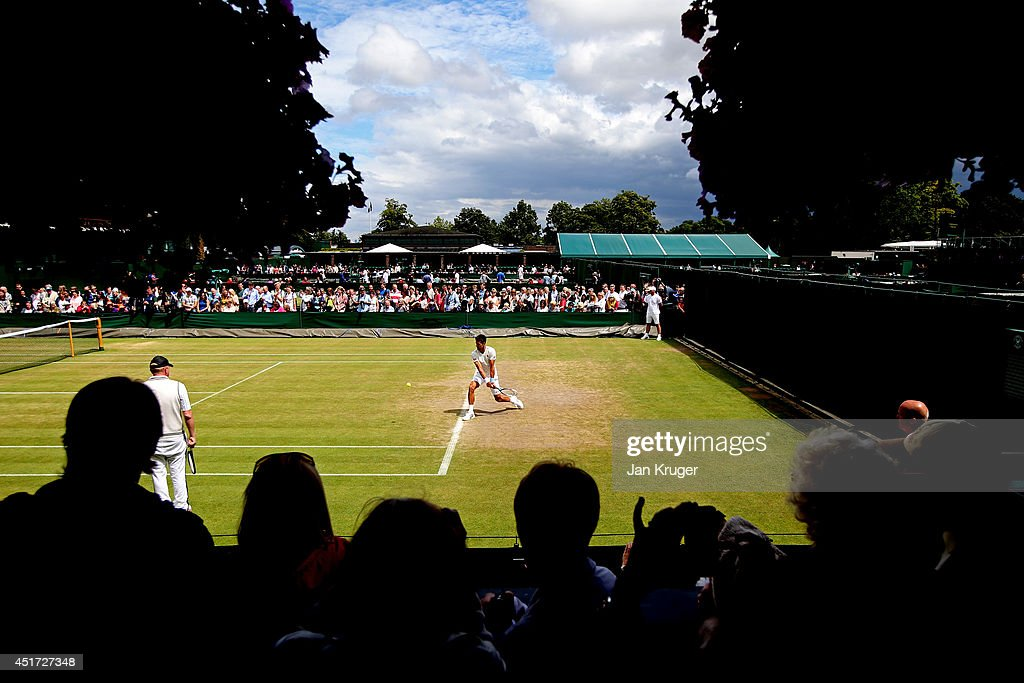 Fans watching Novak Djokovic of Serbia during a practice session on day twelve of the Wimbledon Lawn Tennis Championships at the All England Lawn Tennis and Croquet Club on July 5, 2014 in London, England.