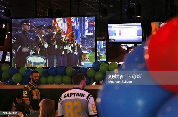 Fans watching Super Bowl 49 at a Buffalo Wild Wings restaurant in the Belmont Shore neighborhood of Long Beach California Fans are drinking beer...