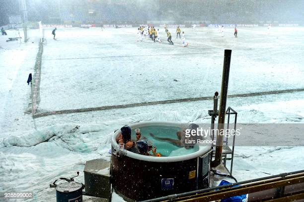 Fans watching the game from a hottub after winning a contest during the Danish Alka Superliga match between Hobro IK and FC Copenhagen at DS Arena on...