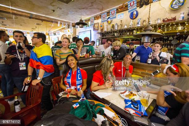 Fans watching the tv football match of the 2018 FIFA World Cup between Argentina and Iceland in the cafe at Moscow downtown on June 16 2018 in Moscow...