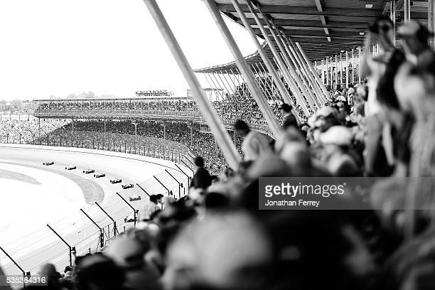 Fans watchthe action during the 100th Running of the Indianapolis 500 Mile Race at Indianapolis Motorspeedway on May 29, 2016 in Indianapolis,...