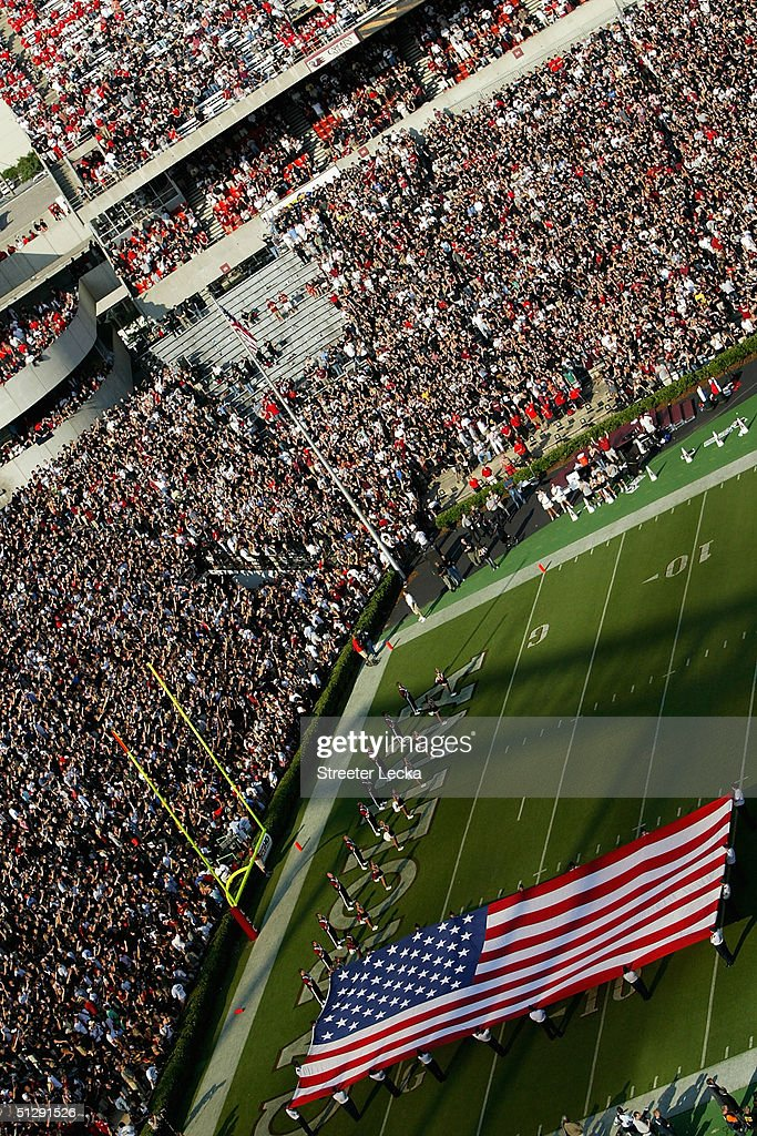 Fans wave American flags during a September 11th tribute at the Georgia Bulldogs versus South Carolina Gamecocks game on September 11, 2004 at Williams-Brice Stadium in Columbia, South Carolina.