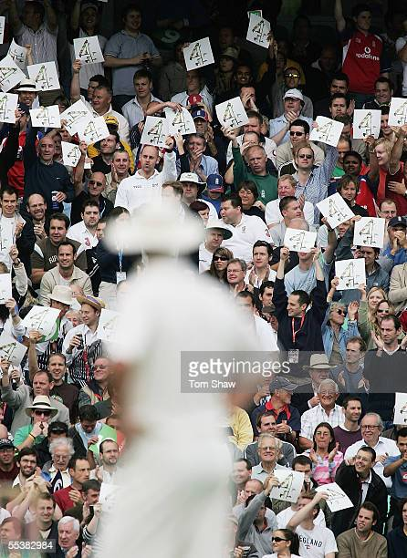 Fans wave Channel 4 cards during day five of the Fifth npower Ashes Test match between England and Australia at the Brit Oval on September 12, 2005...