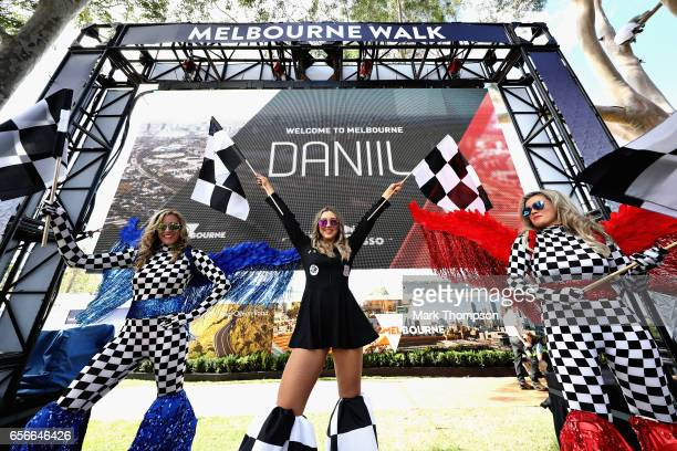 Fans wave flags as they await the arrival of the F1 drivers during previews to the Australian Formula One Grand Prix at Albert Park on March 23 2017...