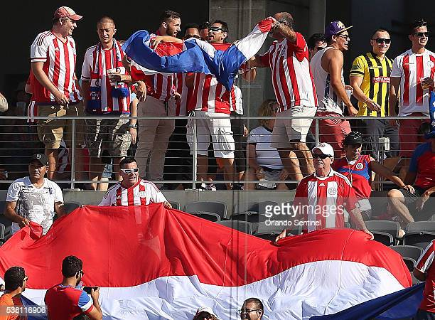Fans wave flags during the Copa America meeting of Costa Rica and Paraguay at Camping World Stadium in Orlando Fla on Saturday June 4 2016 The teams...