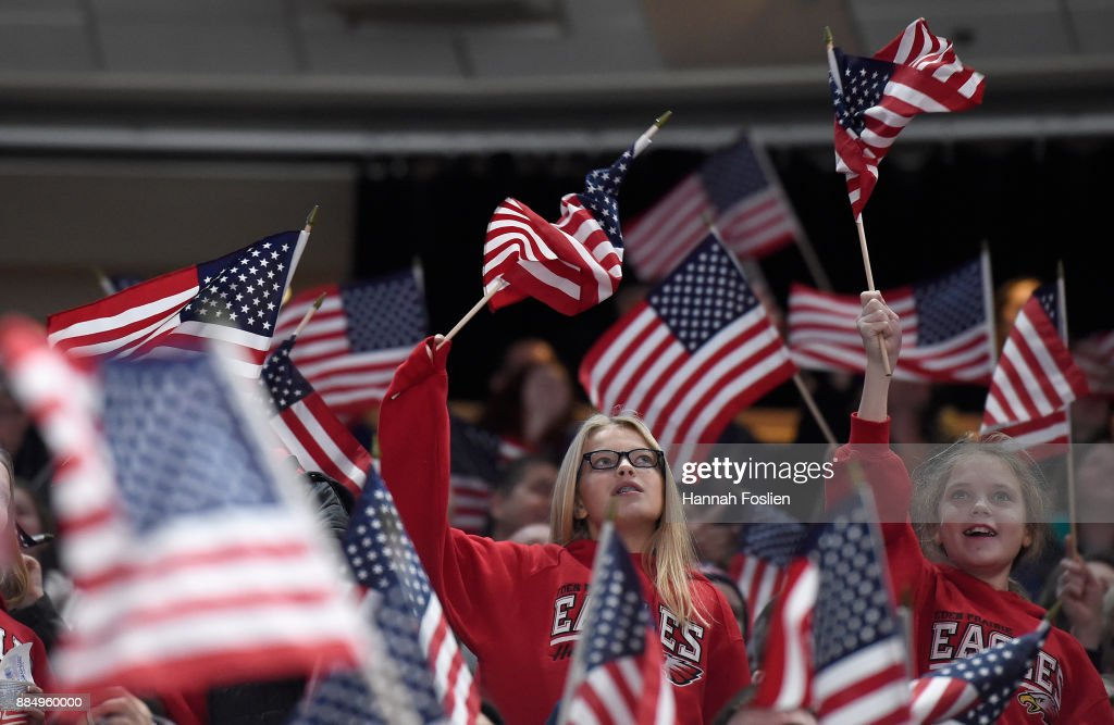 Fans wave flags during the first period of the game between the United States and Canada on December 3, 2017 at Xcel Energy Center in St Paul, Minnesota.