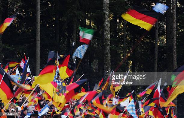 Fans wave flags during the men's 4x7.5 km relay in the Biathlon World Cup on January 11, 2007 in Ruhpolding, Germany.