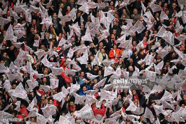 Fans wave flags during the UEFA Champions League Semi Final second leg match between Ajax and Tottenham Hotspur at the Johan Cruyff Arena on May 08...