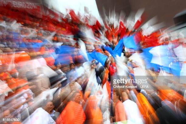 Fans wave flags during the UEFA Women's Euro 2017 Group A match between Netherlands and Norway at Stadion Galgenwaard on July 16 2017 in Utrecht...