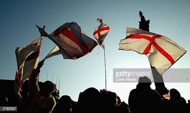 Fans wave flags in Trafalgar Square during the England Rugby World Cup team victory parade December 8 2003 in London Up to half a million supporters...