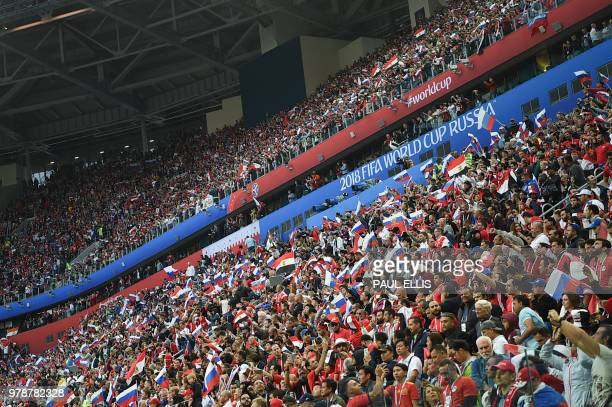 TOPSHOT Fans wave flags prior to the Russia 2018 World Cup Group A football match between Russia and Egypt at the Saint Petersburg Stadium in Saint...